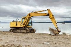 Bulldozer die in een bouwwerf werken Royalty-vrije Stock Afbeeldingen