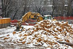 Bulldozer Digger during the work with many rocks and lots of fre Stock Photos