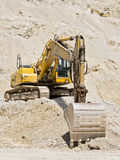 Bulldozer digging Stock Images