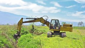 Bulldozer digging land stock video footage