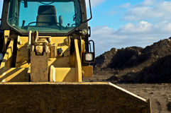 Bulldozer and dirt on contruction site Royalty Free Stock Image