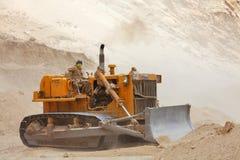 Bulldozer doing mountain road repair Royalty Free Stock Photos