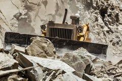 Bulldozer doing road construction in Himalayas Royalty Free Stock Photo
