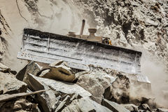 Bulldozer doing road construction in Himalayas Royalty Free Stock Photography