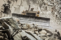 Bulldozer doing road construction in Himalayas Stock Photo