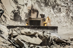 Bulldozer doing road construction in Himalayas Royalty Free Stock Images
