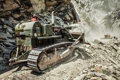 Bulldozer doing road construction in Himalayas Royalty Free Stock Image