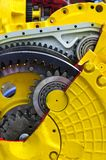 Bulldozer drive gear mechanism. Drive gear and bearings, cross section of bulldozer sprocket internal mechanism, large construction machine with bolts and yellow stock photo