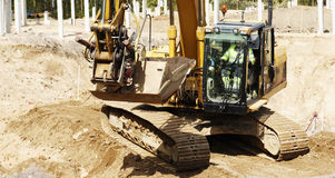 Bulldozer and driver in action Royalty Free Stock Photography