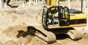 Bulldozer and driver in action Royalty Free Stock Images