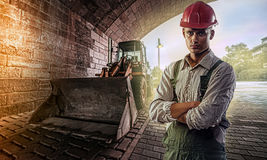 Bulldozer driver. Who is in the tunnel and ready to work royalty free stock photo