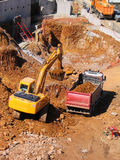 Bulldozer and dump truck. Yellow bulldozer and dump truck at a new construction site Stock Image