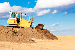 Bulldozer during earth moving works Stock Images
