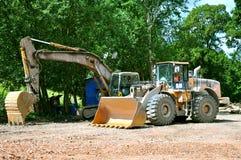 Bulldozer ed escavatore Immagini Stock Libere da Diritti