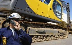 Bulldozer en bestuurder Stock Afbeeldingen