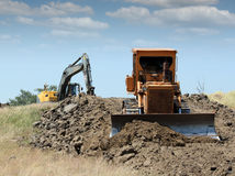 Bulldozer and excavator Stock Images