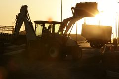 Bulldozer excavator backlight evening sunset Stock Photography
