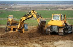 Bulldozer and excavator royalty free stock image