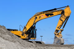 Bulldozer Excavator. Yellow excavator on the blue sky background Royalty Free Stock Photography