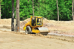 Bulldozer flattening the road Royalty Free Stock Photo
