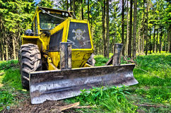 Bulldozer in the forest Royalty Free Stock Photos