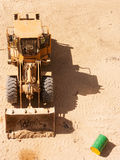 Bulldozer and fuel barrel. From above royalty free stock image