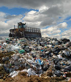 The bulldozer on a garbage dump Stock Image