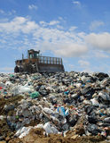 The bulldozer on a garbage dump Stock Images