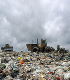 The bulldozer on a garbage dump Stock Photography
