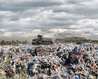 Bulldozer on a garbage dump Stock Images