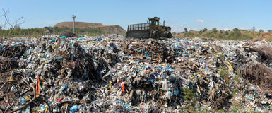 The bulldozer on a garbage dump Royalty Free Stock Photography