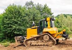 Bulldozer giallo Immagini Stock