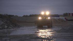 Bulldozer Going Along Piles of Gravel stock video