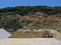 Bulldozer and heaps of sand Stock Images