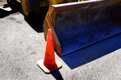Bulldozer Heavy Equipment and Orange Cone Street Repair Stock Images