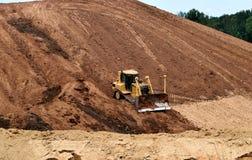 Bulldozer at hill Royalty Free Stock Photography