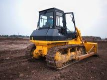 Bulldozer i konstruktion Fotografering för Bildbyråer