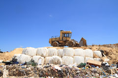 Bulldozer in landfill Royalty Free Stock Photo