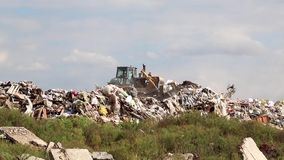 Bulldozer on landfill Royalty Free Stock Image