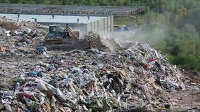 Bulldozer on landfill Stock Photography