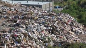 Bulldozer on landfill stock video footage