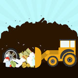 Bulldozer in the landfill. Bulldozer rearranging garbage in landfill. Silhouette of a pile of rubbish in the background. Garbage contains tires, rotten foods Stock Photography