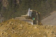 Bulldozer leveling dirt Royalty Free Stock Images