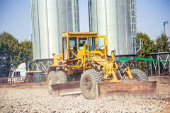 Bulldozer like to land on a building site Stock Photography