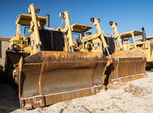 Bulldozer Line Up Stock Photography