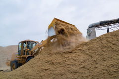 Bulldozer loading rice husk Stock Images