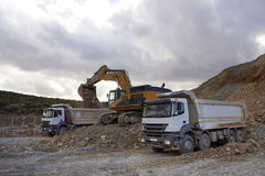 Bulldozer loading sand into the truck Stock Photo