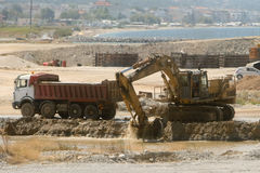 Bulldozer loading a truck Stock Images