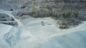 A bulldozer loads rubble in a stone quarry. Aero survey With quadrocopter stock video