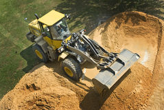 Bulldozer Looking Down. Bulldozer collecting a load of sand Royalty Free Stock Images